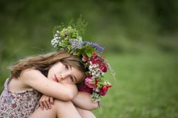 Girl wearing flower crown in meadow in Wendover Buckinghamshire taken by Sarah Greer Photography